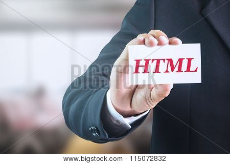 Businessman holding a white sign with the message html.
