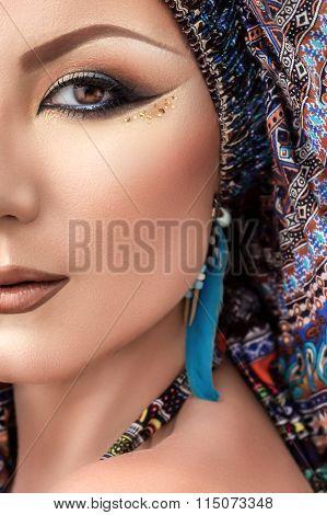 Half face portrait beautiful woman, arabic makeup, colorful turban