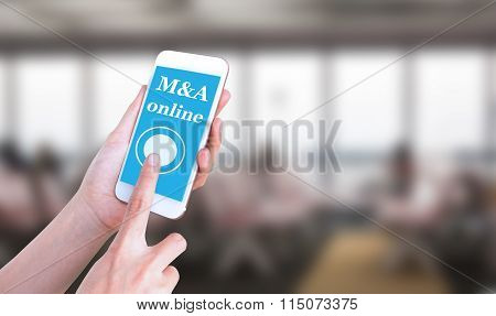 Mobile touch screen phone with text M&A online on the screen
