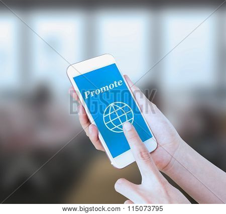 Mobile touch screen phone with text Promote on the screen