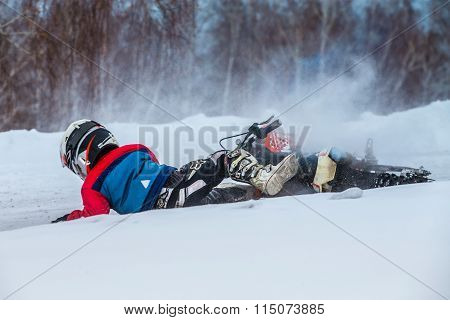 little boy racers on motorcycle fell snowy motocross track