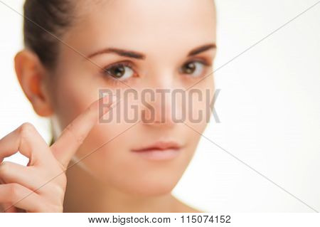 Woman With Contact Lens On Finger Healthcare Concept
