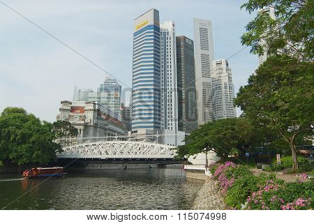 View to the modern buildings and the old Cavenagh bridge in Singapore, Singapore.