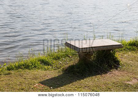 Bench At The Waterside Of The Pond