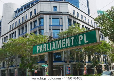 Exterior of the green road sign for Parliament square in Singapore, Singapore.
