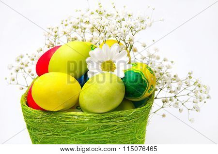 Colorful Easter Eggs And A Basket With Flowers