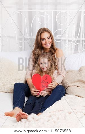 Pretty Mother And Daughter Holding A Cardboard Heart