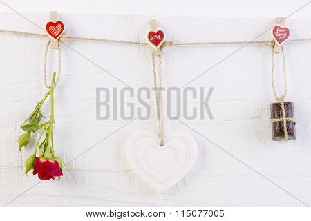 Red Rose With White Shape Heart And Chocolate On White
