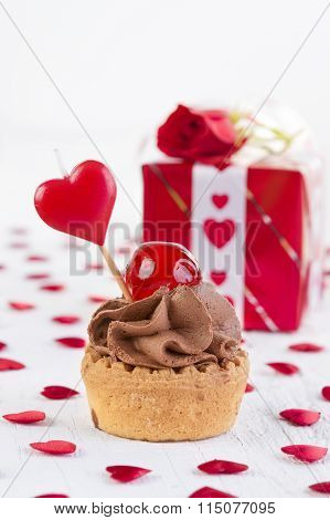 Cupcake With Cherry In Front Of Gift Box