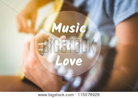 Text background music for love on a woman playing guitar.