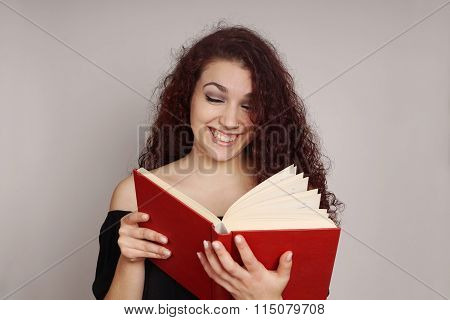 girl reading a funny book