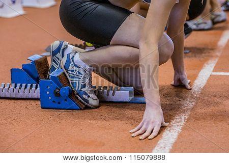 young girl sprinter preparing to start
