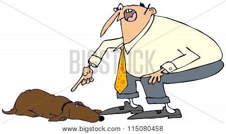 Man scolding a dog