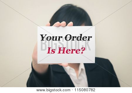 your order is here message on the card Held by women.