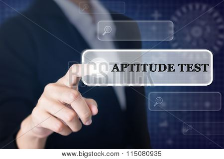 Businessman pressing a APTITUDE TEST concept button.