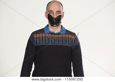 man gagged by tape over mouth