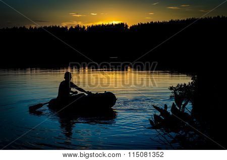 Fisherman In Boat At Sunset