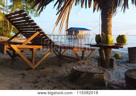 Coconut drink on the Kg Nagalang tropical beach in Labuan island Malaysia
