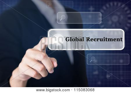 Businessman pressing a Global Recruitment concept button.