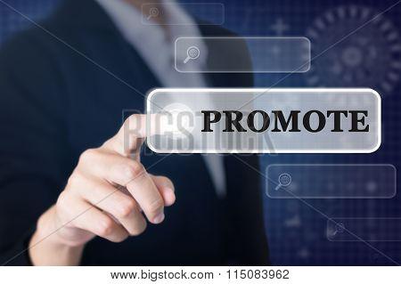 Businessman pressing a PROMOTE concept button.