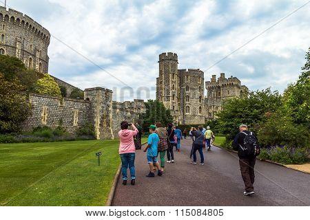 Unidentified Tourists Near Medieval Buildings Inside Windsor Castle