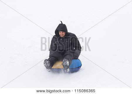 Young Man With Roller Coaster Rides In The Winter