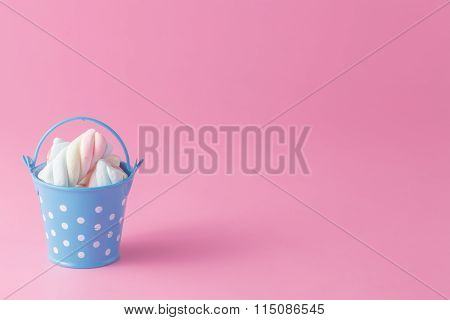 Group Of Twisted Marshmallows In Bucket