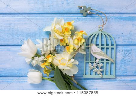 Background With Fresh Spring White And Yellow Flowers And Decorative Bird  On Blue  Painted Wooden P