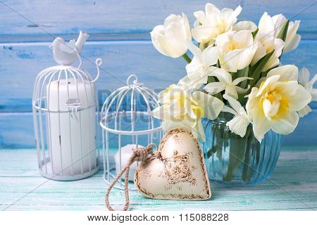 White Daffodils And Tulips  Flowers In Blue Vase, Candles  And Decorative  Heart