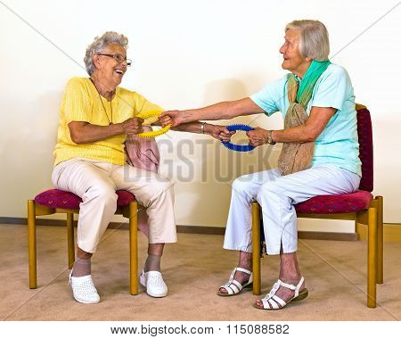 Senior Women Doing Partner Stretches