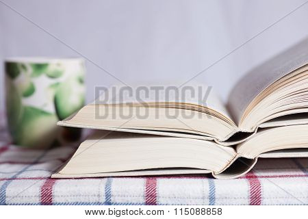 Opened Books On A Table