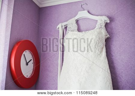 Wedding Dress Hanging On The Wall And Watch Red