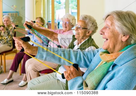 Elderly Ladies Exercising In A Gym