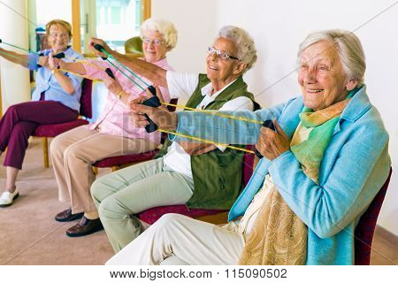 Cheerful Senior Women Exercising Their Arms