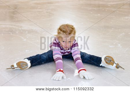 Ice Skating. The Little Girl Sitting On Ice In Ice Skating.
