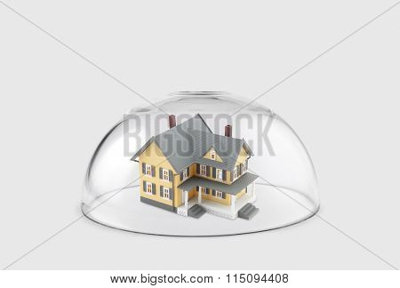House protected under a glass dome