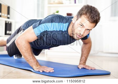 Muscular Man Looking At You While Doing Push Ups