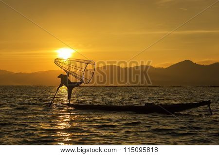 Silhouette Of Fisherman In Inle Lakes Sunset, Myanmar.