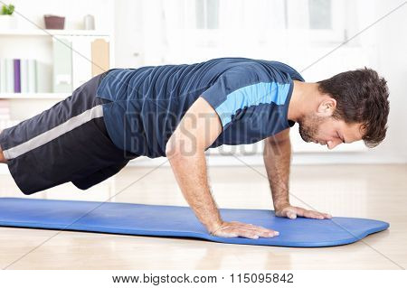 Side View Of An Athletic Man Doing Push Ups
