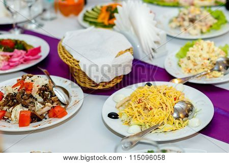 Appetizers And Salads At The Banquet Table