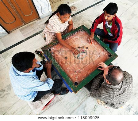 JODHPUR, RTAJASTHAN, 26 March 2015 - People play karrom, traditional game in Jodhpur, Rajasthan, India