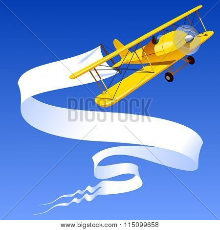 Vintage yellow airplane with blank banner in the blue sky. Contain the Clipping Path