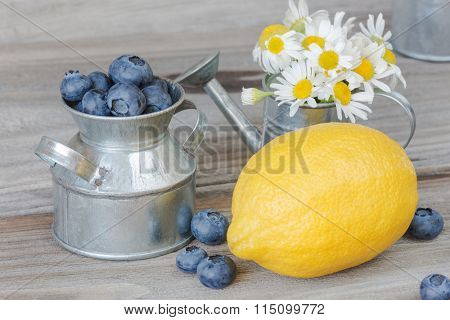 Still Life With Blueberries, Lemon And Chamomiles