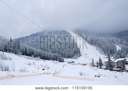 Landscape winter ski slopes in sport village