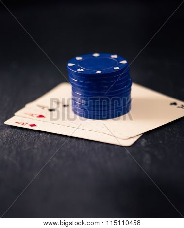 Four Aces And Stack Of Poker Chips