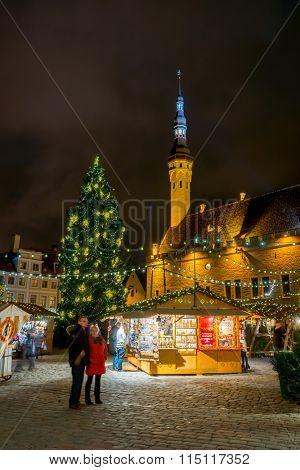 TALLINN, ESTONIA - DECEMBER 24: People visit Christmas Fair in old town at evening on December 24, 2015 in Tallinn, Estonia