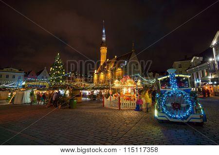 TALLINN, ESTONIA - DECEMBER 23: People visit Christmas Fair in old town at evening on December 23, 2015 in Tallinn, Estonia