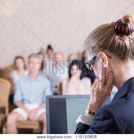 Female Lecturer During Presentation