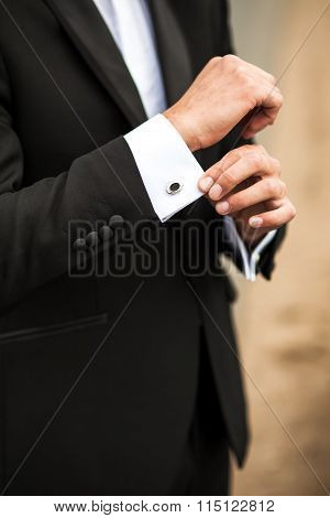 Groom In The Morning Buttoning Cuffs On His Suit