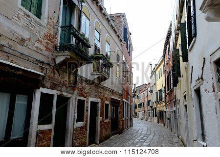 Empty Venetian Street Curves Away From Camera